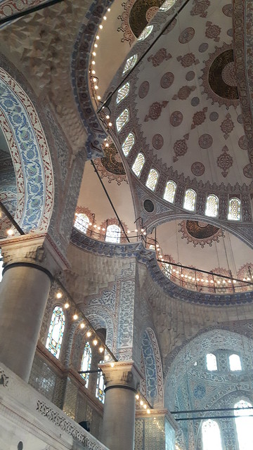 The tiled arches and domes inside the Blue Mosque, Istanbul