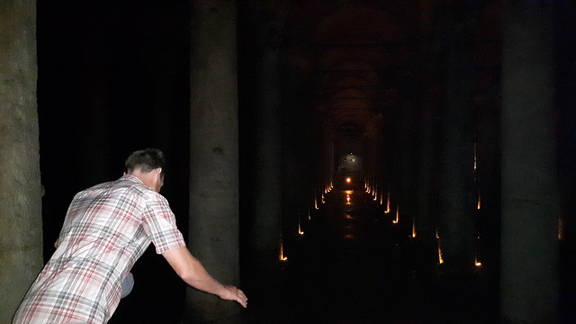 Man leaning over a railing in the Basilica Cistern, Istanbul Turkey