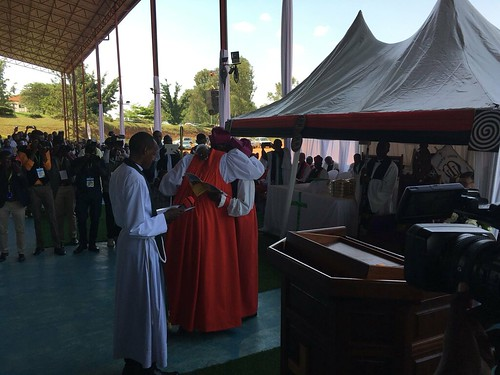 Archbishop Laurent Mbanda embraces Archbishop Onesphore Rwaje as he suceeds him as Primate