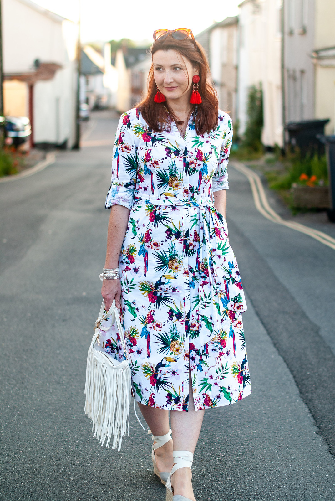 Florals With a Twist | A Loud Birds & Tropical Print \ tropical print midi shirt dress \ grey lace-up espadrilles \ red tassel earrings \ white fringed crossbody bag | Not Dressed As Lamb, over 40 style