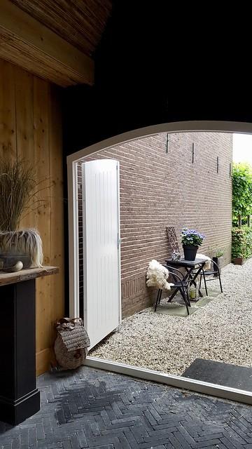 Ronde garagedeur buitenkamer
