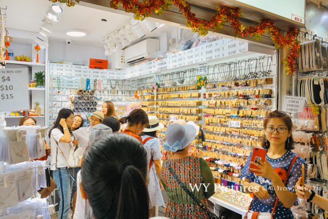 2018 Singapore. Tourists shopping accessories in Bugis Street.