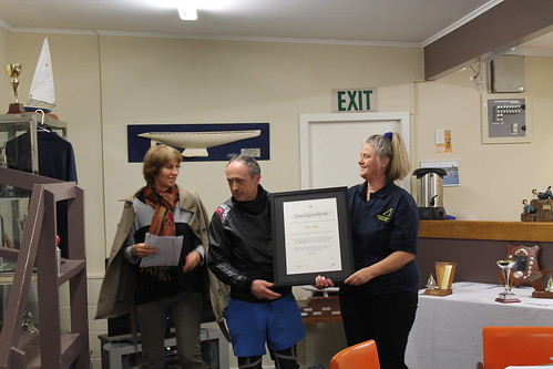 Jeff Coffin receiving his life membership certificate from Shaaron McKee, ex Commodore (2002 to 2008) and Chantal Grass present Commodore (2014 to 2018)