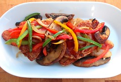 PARMESAN CRUSTED SAUTÉED PORK MEDALLIONS, WITH POTATOES, BELL PEPPERS AND CRIMINI