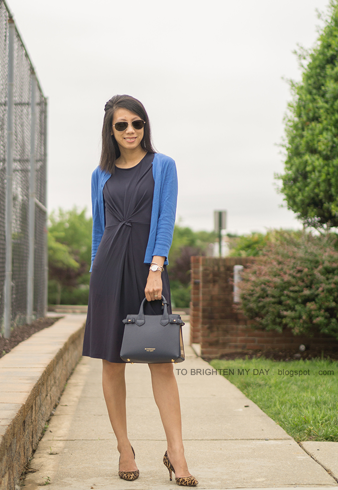 bright blue cardigan, navy twisted front knit dress, navy tote, two tone watch, leopard pumps
