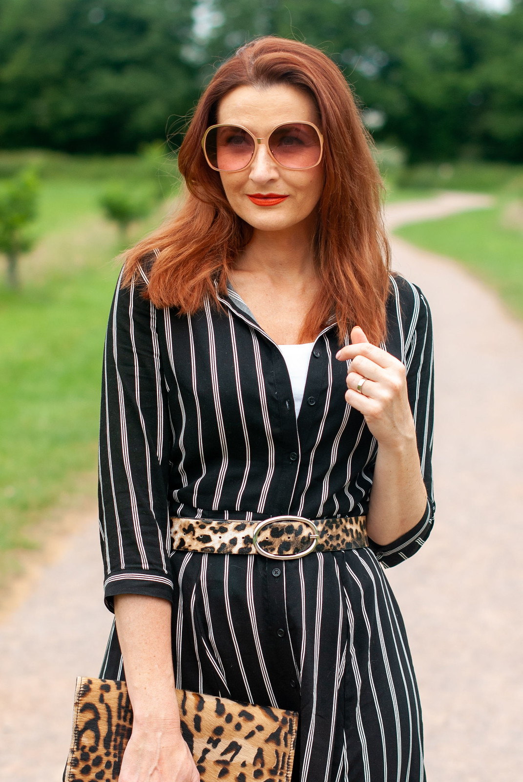 How to Style a Summer Shirt Dress With Pattern Mixing \ black and white striped midi shirt dress \ leopard clutch and belt \ red slingback block heel shoes | Not Dressed As Lamb, over 40 style