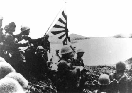 Japanese troops raise the Imperial battle flag on Kiska Island in the Aleutians on June 6, 1942.