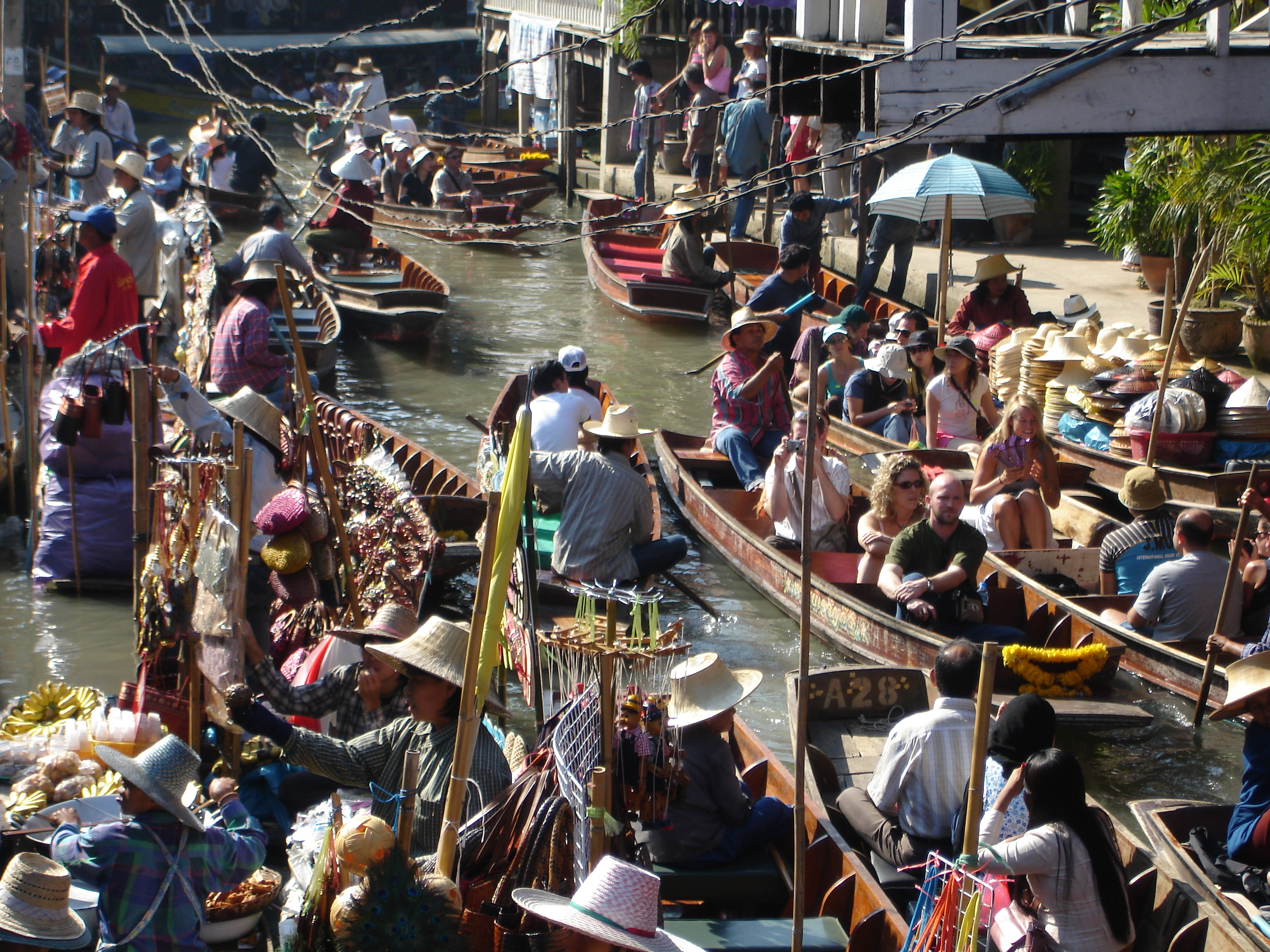 Crowded klong in the main portion of the Damnoen Saduak Floating Market in Thailand. Photo taken by Mark Joseph Jochim on January 10, 2006.