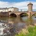 River Monnow/Afon Mymwg flowing under the Monnow Bridge, Monmouth, Wales. UK