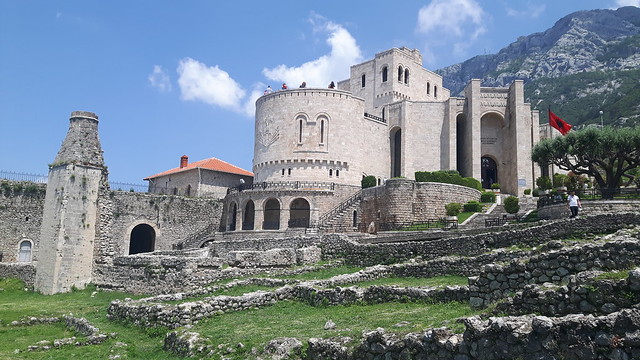 Remains of a castle and a new museum with a mountain backdrop: Kruje, Albania