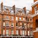Facade of opulent  British Victorian Edwardian terraced flat in red bricks in Chelsea, London.