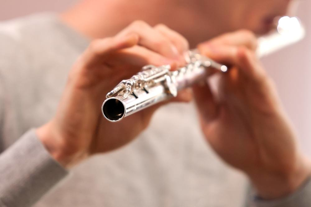 Close-up of flute player