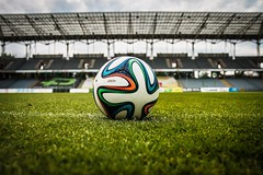 White Black and Green Soccer Ball on Soccer Field - Credit to http://homedust.com/