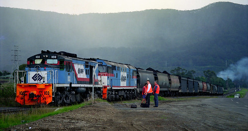 BHP locos 103 and 101 waiting for a crew change? Sometime in the 1990s.