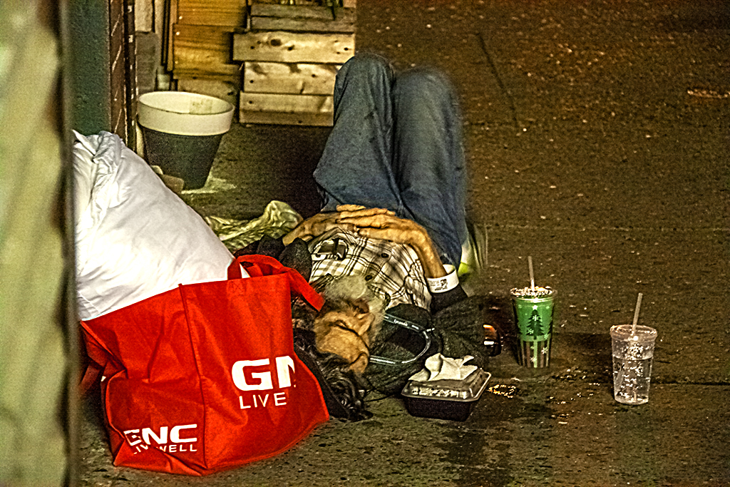 Man sleeping on sidewalk on Washington Avenue on 6-1-18--Italian Market