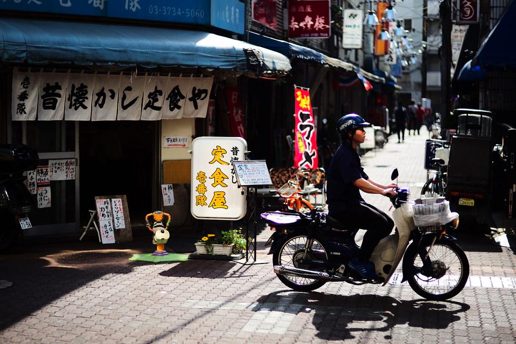 Paper boy riding Honda