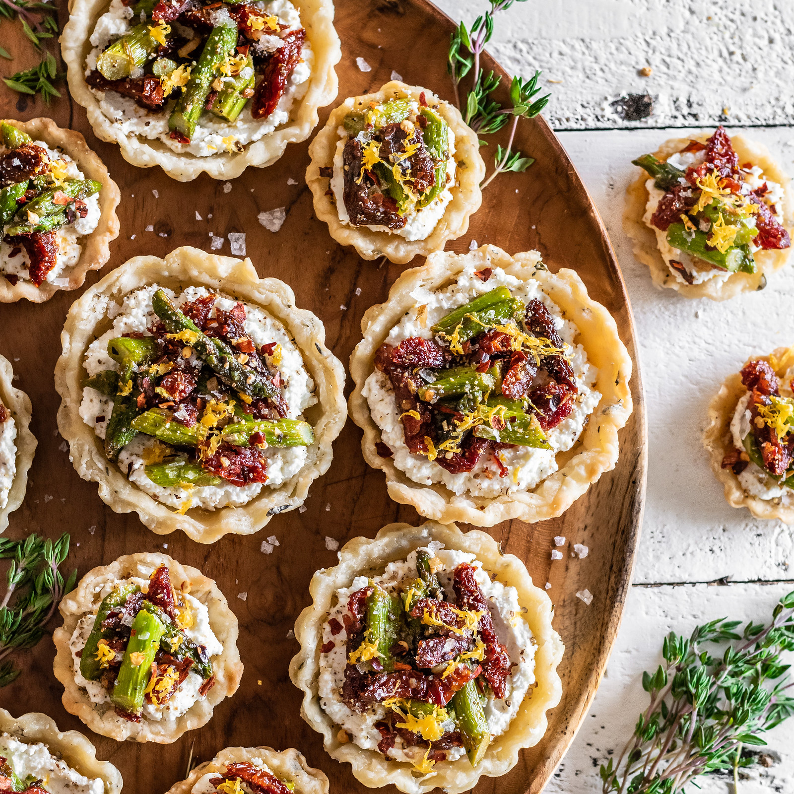 spring tarts with asparagus, sun-dried tomatoes, and goat cheese