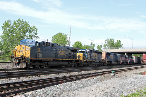 An eclectic mix of power is on Q363-26 as it makes moves at the West end of Frontier Yard. Guilford units BM 333 and MEC 343 are dead in tow at the rear of the consist.
