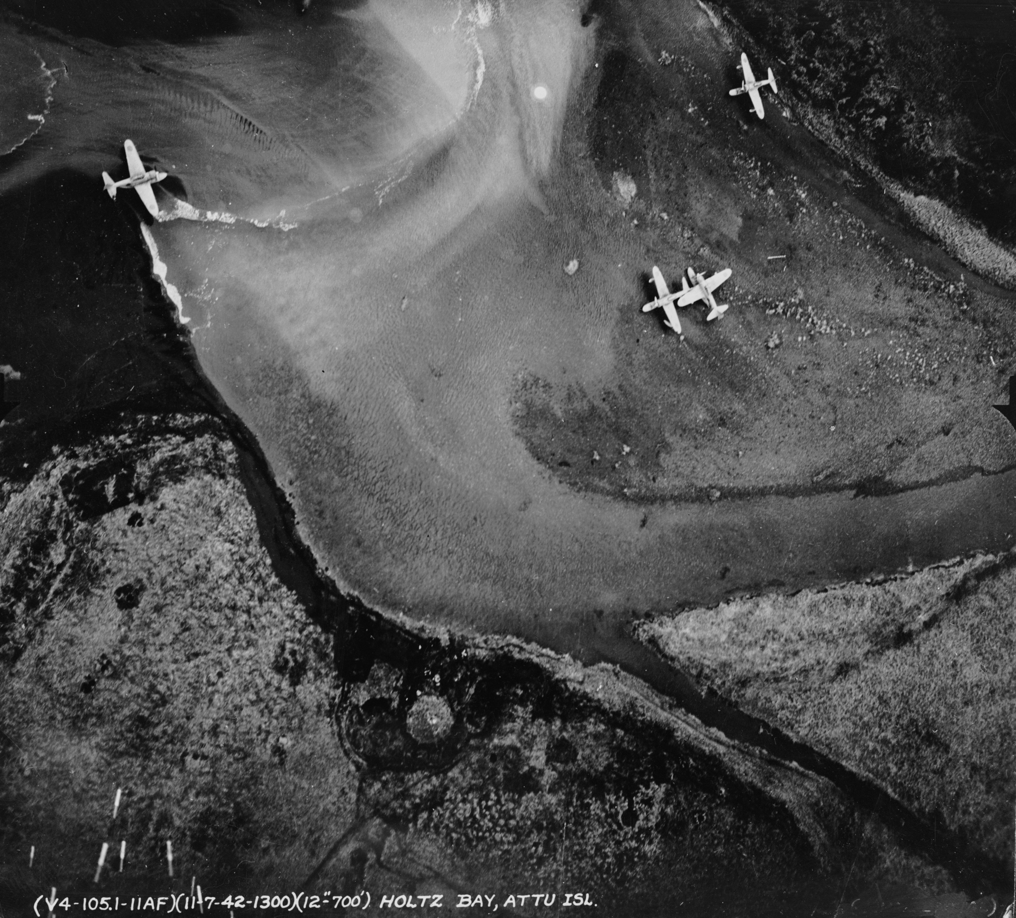 Four Japanese Misubishi A6M-2N Rufe seaplane fighters at Holtz Bay, Attu Island, Aleutian Islands (USA), on November 7, 1942, photographed by a USAAF plane. Note that the two planes in the center obviously have collided and been damaged.