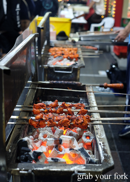 Chicken tikka skewers on the charcoal bbq at Lakemba Ramadan Food Festival 2018 on Haldon Street
