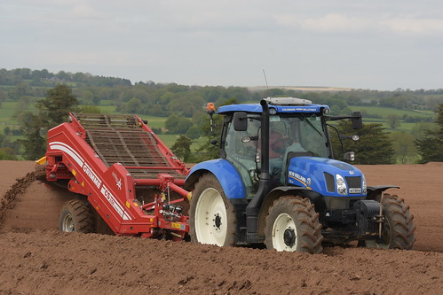 New Holland T6.175 Tractor with a Grimme Rota Power CS150 Destoner