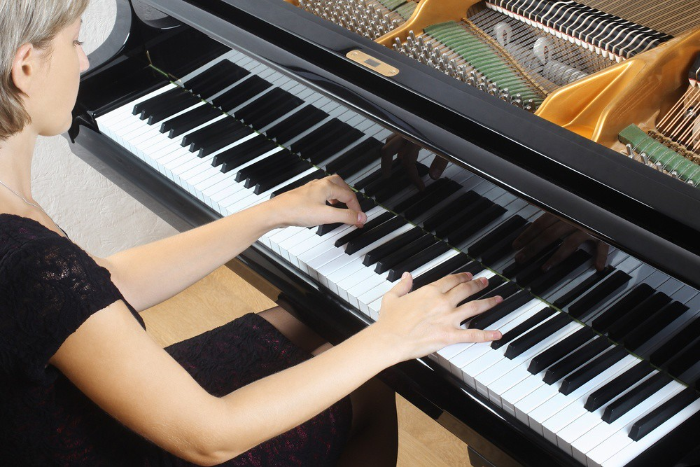overhead view of woman practicing piano