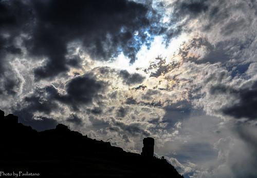 travel peru andes altiplano landscape mountains sillustani sky cloud ancient building architecture sun tower people