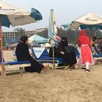 Ladies in burkhas on the beach