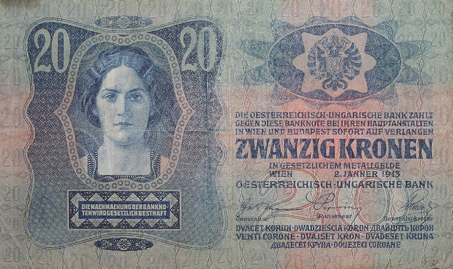 A 1913 20-crown banknote of the Dual Monarchy, using all official and recognized languages: Czech, Polish, Ruthenian (Ukrainian), Italian, Slovene, Croatian, Serbian, Romanian; the back side is in Hungarian. The note reads: The Austro-Hungarian bank shall, on demand, immediately pay for this banknote, at its head offices in Vienna and Budapest, TWENTY CROWNS in statutory metal coinage. Counterfeiting banknotes is punishable by law.
