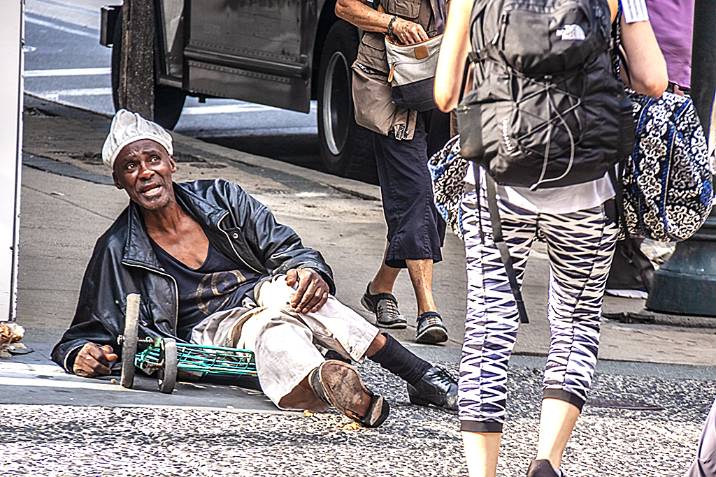 Beggar on ground at 12th and Walnut--Center City