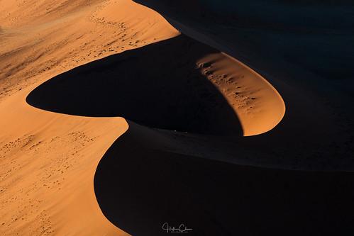 doorlesshelicopter lines sossusvlei sunset curves namibia sanddunes abstract deepshadows landscapephotography aerialphotography namibdesert namibnaukluftnationalpark hardapregion na