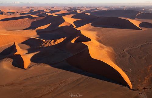 doorlesshelicopter namibdesert leadinglines scale sunset namibia sanddunes cars sossusvlei deepshadows aerialphotography landscapephotography namibnaukluftnationalpark hardapregion na