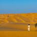 Omani man standing near a tree in the rub al khali desert, Dhofar Governorate, Rub al Khali, Oman by Eric Lafforgue