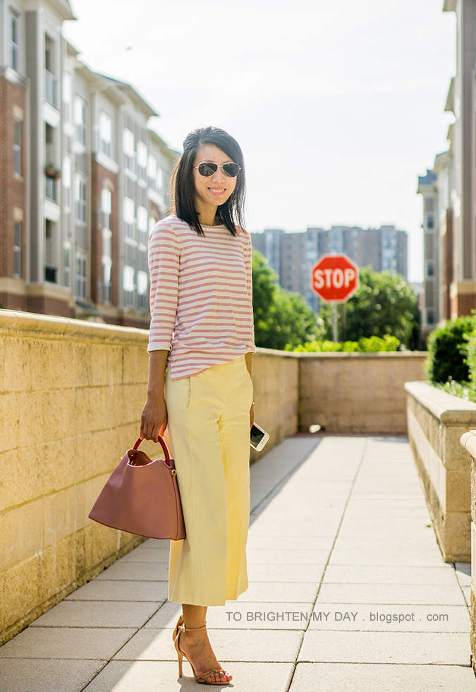 pink striped top, rose gold cuff, yellow wide leg cropped pants, pink bucket tote, brown sandals with knot