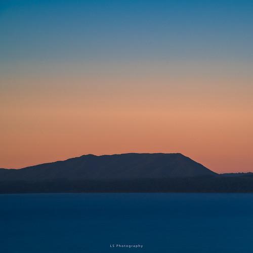 pucón regióndelaaraucanía chile cl kiltro villarrica lake lago agua water blue orange dusk sunset nature landscape longexposure