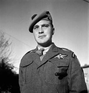 Major S.L. Dymond, formerly of the First Special Service Force, currently Officer in Command of the liberated Esterwegen concentration camp... / Le major S.L. Dymond, auparavant de la Première Force de Service spécial, supervisant l'ancien camp de co