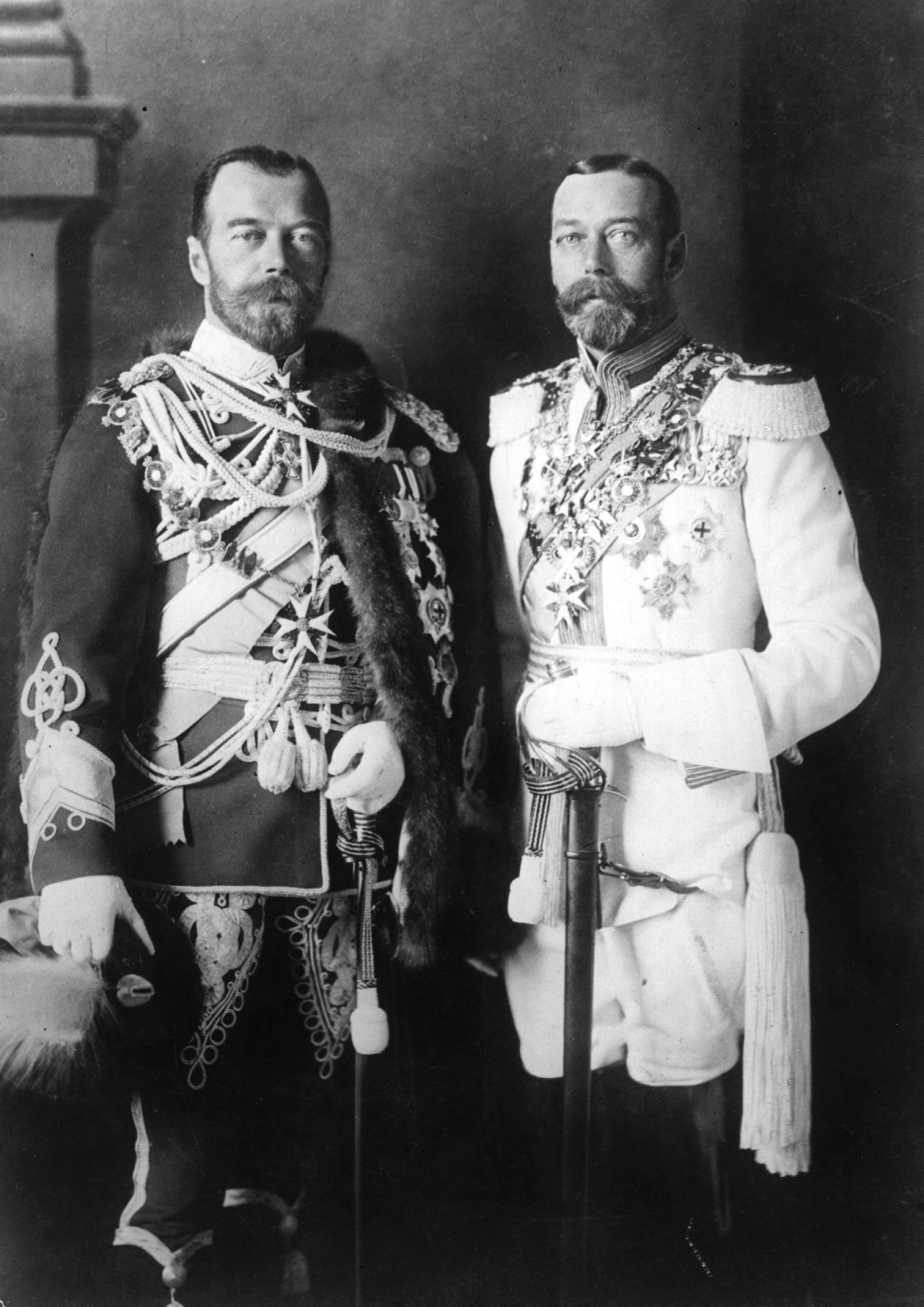 George V (right) and his physically similar cousin Nicholas II of Russia in German uniforms before the war. Photo by Hulton Archive on May 26, 1913.