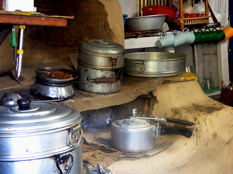 Kitchen at one of the local Tea Houses in Nepal showing pots cooking over open fires