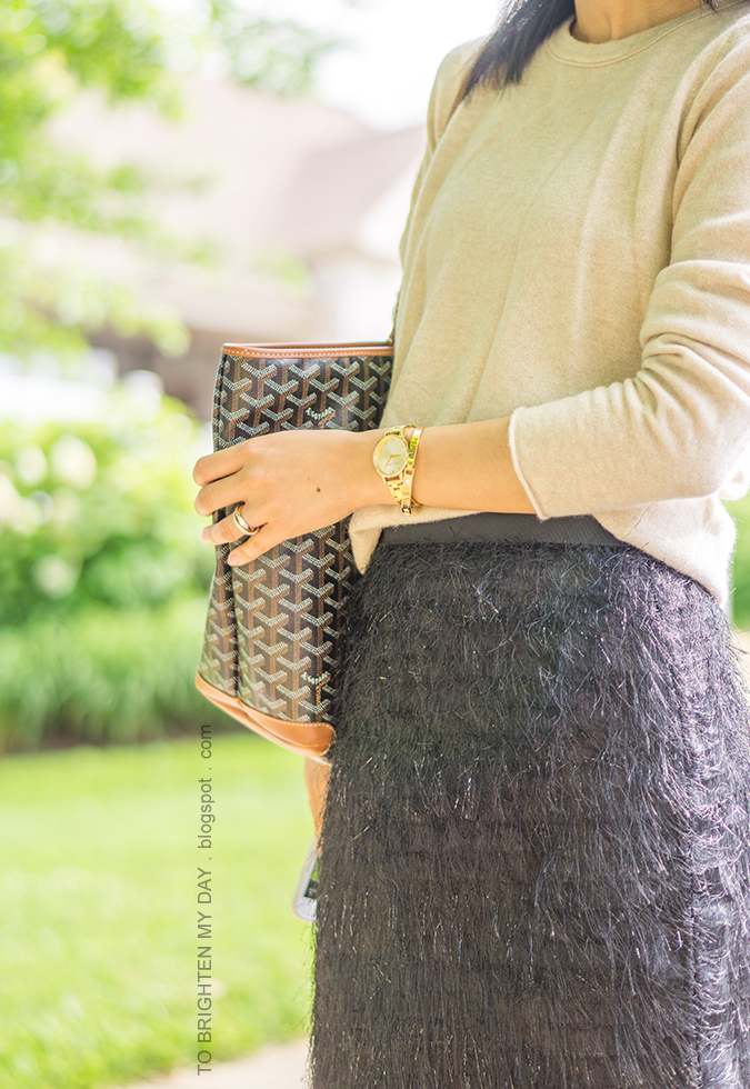 camel cashmere sweater, gold watch, gold bangle, patterned tote, black pencil skirt with fringe