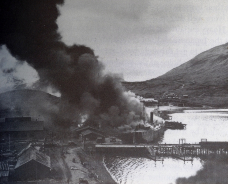 Barracks ship Northwestern engulfed by flames in Dutch Harbor after the second Japanese airstrike, June 4, 1942.