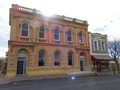 Moonta. Old copper mining town. This grand banking facade in the classical style was built in 1865 for the Bank of SA. Became the Union Bank as shown on parapet in 1892. Closed as a bank in 1943. Old 19th century chemist shop next door.