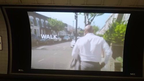 Walk/Cycle promotion video on a digital ad display in a London Underground station