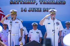 Rear Adm. Joey Tynch, right, commander of Logistics Group Western Pacific, and Vice Adm. Rassadang Teeranet, commander-in-chief of the Royal Thai Navy, render salutes during the opening ceremony of CARAT Thailand, June 14. (U.S. Navy/MC3 Christopher A. Veloicaza)