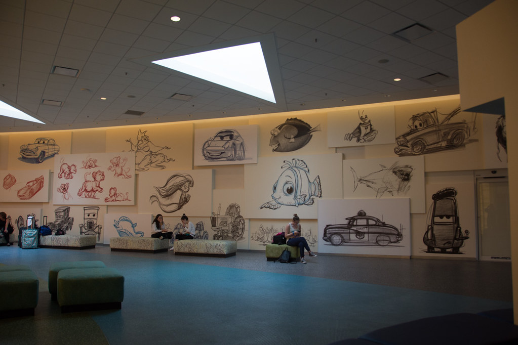 Sketches and drawings on wall at Art of Animation