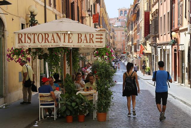 Strolling down the charming Via della Vite in Roma