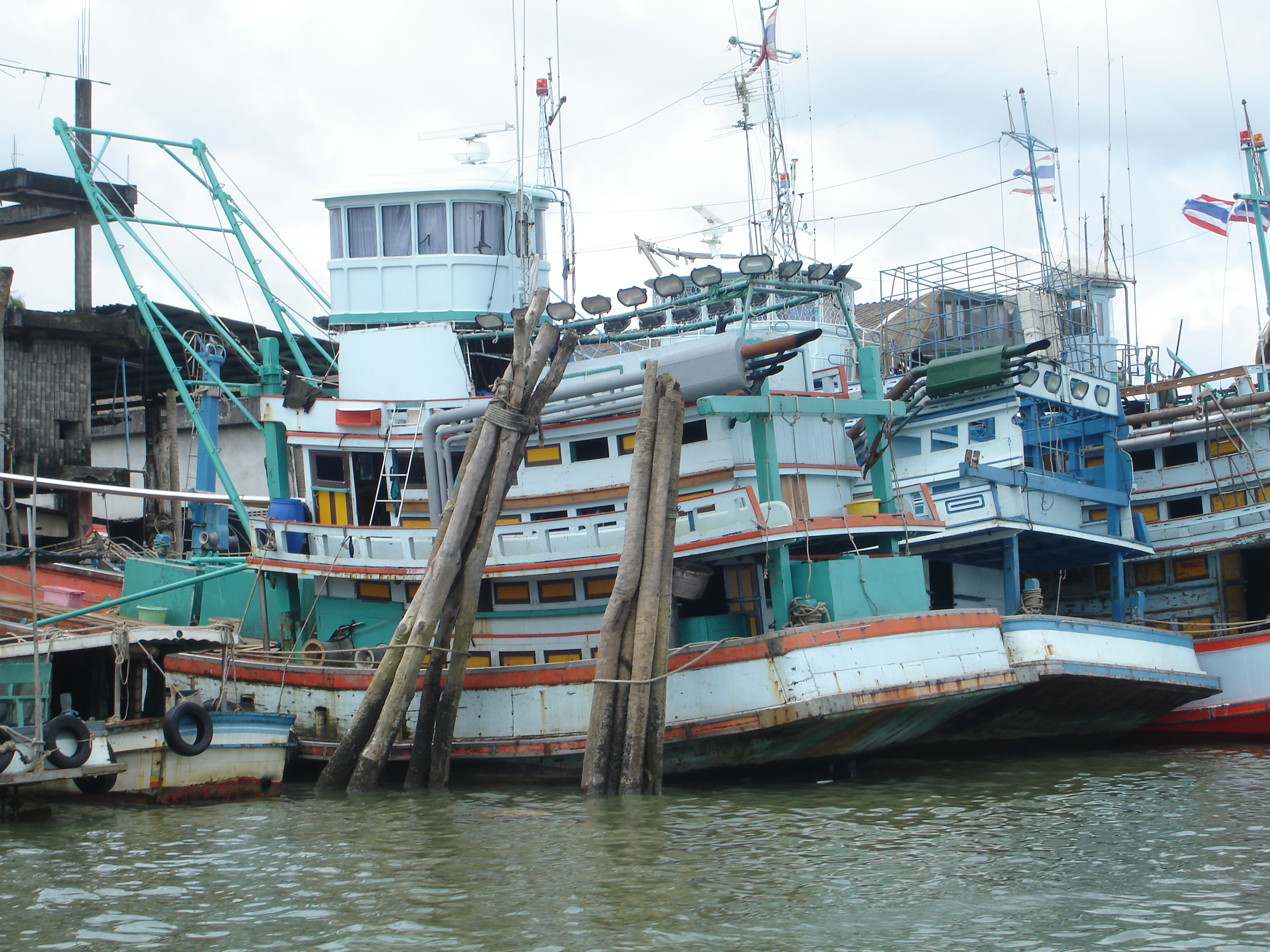 Thai fishing boats moored at Ranong, Thailand. Photo taken by Mark Joseph Jochim on July 4, 2006.