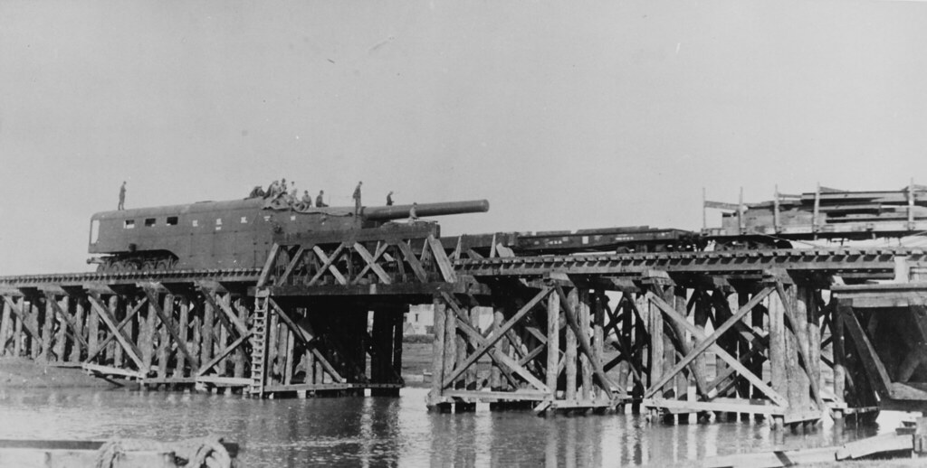 14 inch naval railway gun. Crossing a wooden trestle bridge, en route to the front in France, 1918.