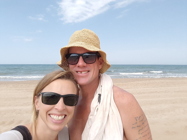 A couple on a beautiful beach in Oliva, Spain.