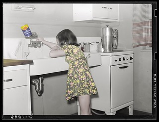 Stepping out of time Child in kitchen