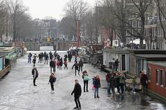 Schaatsen op de grachten Amsterdam
